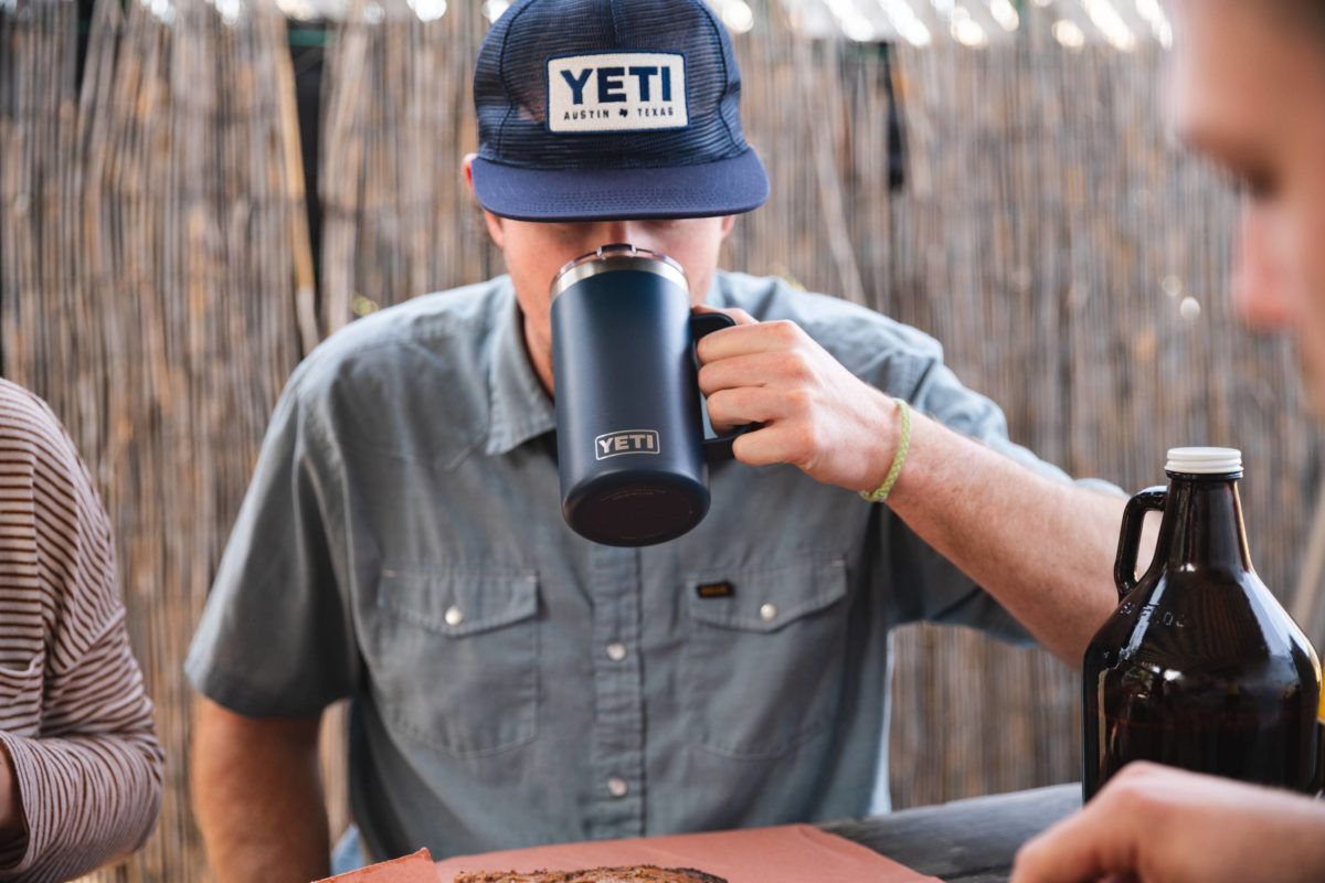 A man drinking from a Yeti thermos